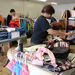 Gail Robinson and Rhonda Washington, both of Elyria, sort through clothes at a soon-to-be open thrift shop in Elyria on Aug. 12. KRISTIN BAUER | CHRONICLE