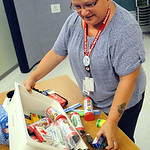 Linda Taylor,  a Red Cross volunteer from Lorain and leader for the pillowcase project, sorts through emergency preparedness items at the American Red Cross in Elyria on Aug. 12. STEVE MANHE …