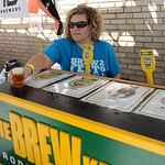 Lori Cannon, of Avon, helps serve selections from the Brew Kettle, of Strongsville, during the Lorain Brew Fest on Aug. 23. KRISTIN BAUER | CHRONICLE