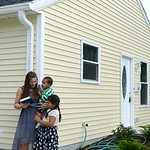 Tara Anson and her children Jordan, 20 months, and Makayla Matear, 6, of Elyria stand in front of their new home on Aug. 19. KRISTIN BAUER | CHRONICLE