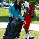 Sandra Schoolcraft, 17, and Djuan Taylor, 17, both of Lorain, clean up trash at Black River Landing on Aug. 15.   KRISTIN BAUER | CHRONICLE