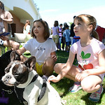 Ashley King, 10, of Avon, Laura Freeman, 9, of North Ridgeville, and Erin Till, 7, of Avon, listen as they learn about the different breeds of dogs, including french bulldogs Pinky and Coco, …