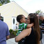 Tara Anson receives a kiss from her son Jordan Matear, 20 months, on Aug. 19 while surrounded by friends and family for their house blessing. KRISTIN BAUER | CHRONICLE