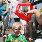 Jett Sikora, 4, of Elyria, smiles with excitement as he waits for a balloon artist to finish making him at hat during the final day of the fourth annual Our Lady Queen of Peace Home Days Fes …