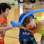Riley Hawkins, 8, Phillip Lilly, 8, and Cody Turvey, 8, all of Elyria, play with their inflatable balloon swords on Aug. 6.  KRISTIN BAUER | CHRONICLE