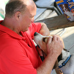 Dr. Tom Joyce, Pastor of Fields United Methodist Church in North Ridgeville, places a blessing on Bailey, a 5-year-old beagle owned by Jody Lack, of North Ridgeville during the second annual …