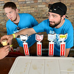 Chris Nabakowski, of Amherst, and Zach Novosielski, of Elyria, serve selections from Lagerheads Brewing Company, out of Medina, to patrons attending the Lorain Brew Fest on Aug. 23. KRISTIN …