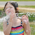 On a hot July day, Kaetlynn Fralick, 6, of Grafton splashes in the cool water at the North Park Splash Pad in Grafton on July 22. KRISTIN BAUER | CHRONICLE