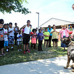 Lorain Police officer Eric Alten, of the Community Impact K-9 Unit, and K-9 Garp visit children at Marshall Plaza Apartments in Lorain for an anti-drug and safety demonstration on July 11. S …