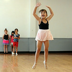 Khloe Racz, 5, of Elyria, front, learns how to jump on the first day of Ballet and Jazz Combo Class at Elyria YWCA Summer Dance program on July 7.  In rear are Alyssa Thompson, Adrianna Rotu …