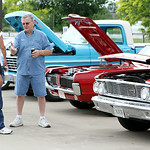 Chuck Lowery, of Elyria, left, talks with Terry Wilburn, of North Ridgeville in front of their vehicles, Lowery's 1964 Ford Galaxie and Wilburn's 1968 Mecury Cougar. ANNA NORRIS/CHRONICLE