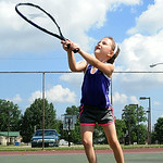Maggi Kayden, 6, of Elyria, learns how to handle the racket during a tennis lesson with her sister Angela at South Park tennis courts in Elyria on July 15. STEVE MANHEIM/CHRONICLE