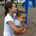 Tatum McNeal, 8, hugs Larissa Owens, 6, at the Boys and Girls Club of Elyria on July 16.   KRISTIN BAUER | CHRONICLE