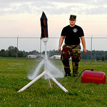 U.S. Air Force Auxiliary Cadet 2nd Lt. Adam Wagner, 16, of Amherst, helps launch a rocket made out of a 2-liter bottle at the Lorain County Regional Airport on July 1.   KRISTIN BAUER | CHRO …