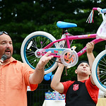 Allan Fee, from Q104 and Tony Kitson, from the Elyria Salvation Army, auction off a bicycle at the Soup Kitchen Cook-Off fundraiser on July 26.   KRISTIN BAUER | CHRONICLE1