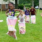 Jaiden Alston, 10, leads the pack as she runs through an obstacle course set up at the Lorain Metropolitan Housing Authority on July 19. KRISTIN BAUER | CHRONICLE