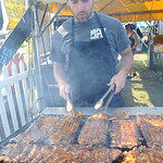 Mike Sampson of Pigfoot BBQ in Medina cooks ribs at the first annual Ribs on the River at Black River Landing in Lorain on July 31.  Award winning National Rib vendors, live entetainment, ve …