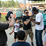 Charles Ramsey visits with his fans before the start of the Crushers game on July 31. Ramsey was at the Crushers game signing books and greeting fans.  KRISTIN BAUER | CHRONICLE