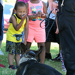 Nathaniel Velazquez and Joslynn Blackman visit with K-9 Garp on July 11. STEVE MANHEIM/CHRONICLE