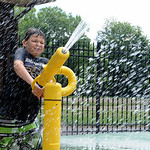 Chase Loeffler, 9, of North Ridgeville, plays in the reopened Splash Pad at South Centralk Park on July 9.  STEVE MANHEIM/CHRONICLE