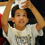 James Wells, 11, of Elyria, mixes borax, corn starch, hot water and glue to make a bouncy ball at the Mad Science Camp at East Recreation Center on July 23. STEVE MANHEIM/CHRONICLE