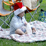Jonathan Konnerth, 6, of Vermilion enjoys popcorn while watching a movie in Exchange Park during Vermilion's annual Christmas in July festivities on July 25. KRISTIN BAUER | CHRONICLE