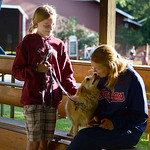 Kaitlyn Praisler, 12, of West Salem, and her dog Honey greet Kaitlyn's mother, Kathy Wood, at the Medina County Fair. KRISTIN BAUER | CHRONICLE