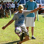 Cody Hansen, 15, of Hudson, Wis., plays a game of soccer with Sam Giesregen, 17, of Lakeland, Minn., during a community picnic on July 24. KRISTIN BAUER | CHRONICLE