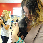 Heather MacLechlan, right, of Westlake, holds Sparky, with Shelby Gaydosh, an intern with LCADA, at Leadership Lorain County's 2014 'Meet a Friend Social' at Friendship APL in Elyria on July …