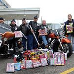 Elyria Eagle Riders Jennifer Dahleeck, Brian Gawlik, Mike Lukehart, Ronnie Galindo, Ray Drake, Diane Kundrod and Dena Flanagan dropped off toys on Dec. 12. STEVE MANHEIM/CHRONICLE