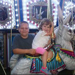 Deric and Emma enjoy the rides on the midway.