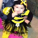 Nevaeh, 8 months, is a bumble bee for her first Halloween.