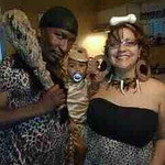Hosea and Damaris pose with their baby monkey, Hosea Jr., 1.