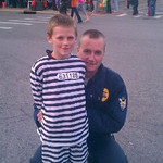 Inmate Thomas Foley, 7, is held in custody by security guard Tom Foley.