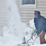 Donna Kaminski's neighbor clears his driveway on Bellfield Street.