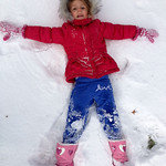 Mali Alberts, 4, of Elyria, makes a snow angel on Nov. 12.