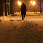 An unidentified indivdual walks alone through Tappan Square in Oberlin. Photo by Dawn Neely Randall.