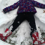 Keira Franklin, 8, makes a snow angel in Ely Square on Dec. 14.