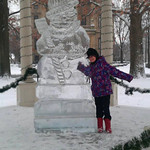 Keira Franklin, 8, poses with the ice sculpture in Ely Square on Dec. 14.
