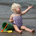 Kaylie Brown, 1, beckons from the shore of Lake Erie in Vermilion on Labor Day. RAY RIEDEL/CHRONICLE