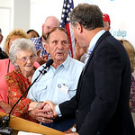 Surrounded by family members, Catherine Lockhart and her husband, Eugene Lockhart, 90, shake hands with Sen. Sherrod Brown. Lockhart was awarded a Bronze Star for his service in World War …