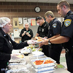 Sandra Anderson, left, of Elyria Olive Garden, serves lunch to Elyria Police Officers Ligas, left, Cooley and Taylor. Lisa Mutnansky opens the salad dressing in the background. RAY RIEDEL/CH …
