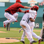 Los Angeles Angels' Mike Napoli, left, and Erick Aybar, right congratulate Howie Kendrick as he scores the game-winning run during the 11th inning of Game 3 of the American League Championsh …