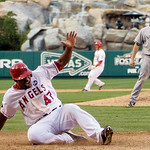 Los Angeles Angels' Howie Kendrick (47) scores the game-winning run in front of New York Yankees' David Robertson on a double by Jeff Mathis during the 11th inning of Game 3 of the American  …