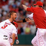 Los Angeles Angels' Jeff Mathis (5), back left, is congratulated by teammates after hitting a double to score Howie Kendrick to beat the Yankees 5-4 in the eleventh inning of Game 3 of the A …