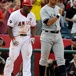 Los Angeles Angels' Howie Kendrick reacts in front of New York Yankees' Alex Rodriguez after Kendrick hit a triple during the seventh inning of Game 3 of the American League Championship bas …