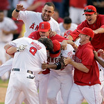 ** CORRECTS ANGELS PLAYER SCORED TO HOWIE KENDRICK  ** Los Angeles Angels' Jeff Mathis (5) is congratulated by his teammates after he hit a double to score Howie Kendrick to beat the Yankees …
