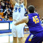 Midview Riley Moore takes a shot over Avon Alex Isaac Feb. 15.  Steve Manheim