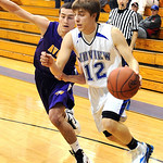 Midview Eddie Brezina is fouled going to hoop by Avon RJ Kaufmann Feb. 15.  Steve Manheim/CT
