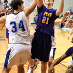 Avon Ryan Poyle puts up shot over Midview Riley Moore Feb. 15.   Steve Manheim